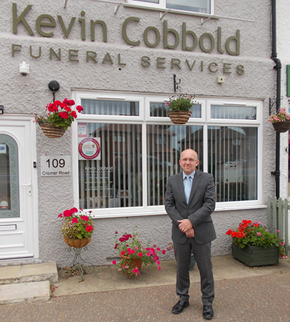 A picture of the owner - Kevin Cobbold Funeral Director outside Kevin Cobbold Funeral Services in Norwich